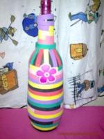 Como hacer con tus propias manos un botella decorada con goma eva
